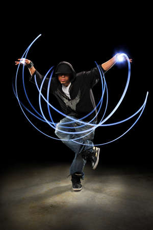African American hip hop dancer performing with light painting photo