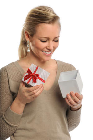 Portrait of beautiful young woman holding gift box isolated over white background