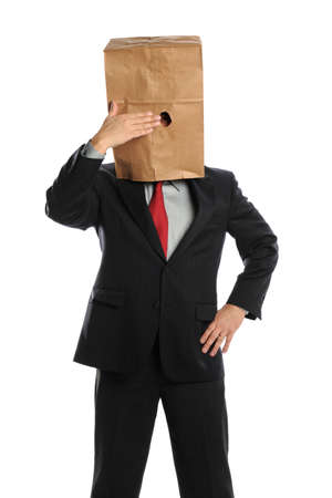 humiliation: Portrait of businessman hiding behind paper bag isolated over white background
