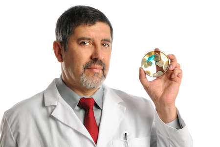 serious doctor: Hispanic lab technician showing petri dish with bacteria growth isolated over white background