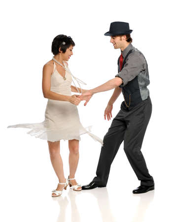 Young couple dancing isolated over white background