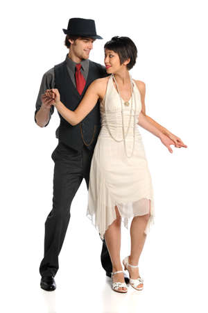 Portrait of young couple dancing isolated over white background photo