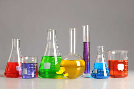 Laboratory glassware on table over neutral background -With Clipping Path Stock Photo