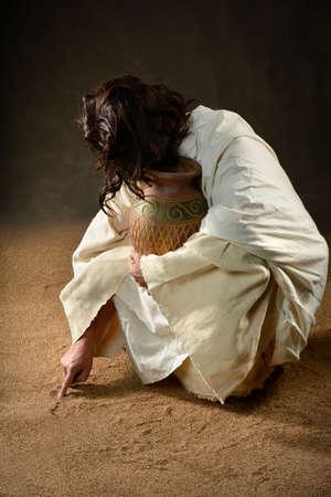 Jezus schrijven met vinger in het zand