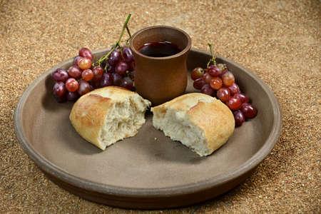 Bread, grapes and wine as Communion symbols photo