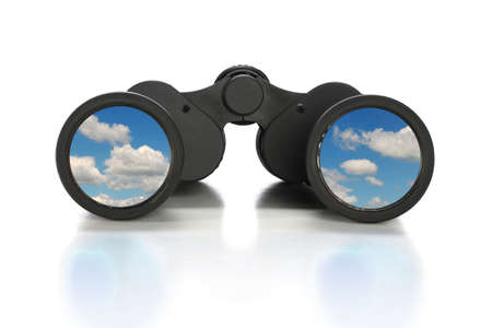 front view: Binoculars with image of clouds over reflective table