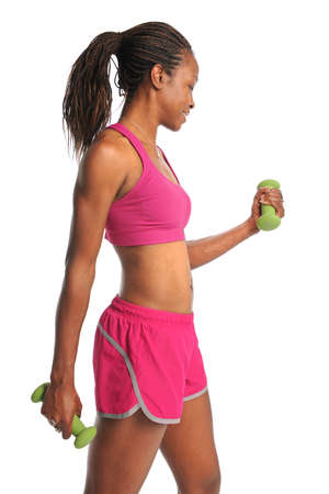 Young African American woman exercising with dumbbells isolated over white photo