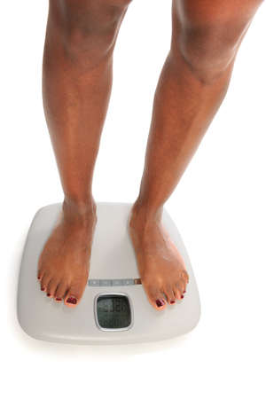 Young African american woman on scales photo