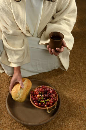 Jesus hands holding communion symbols: bread and wine photo
