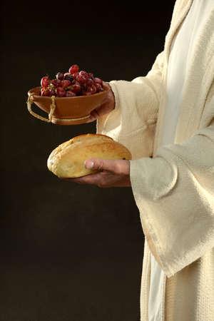Jesus holding bread and grapes symbols of communion Stock Photo