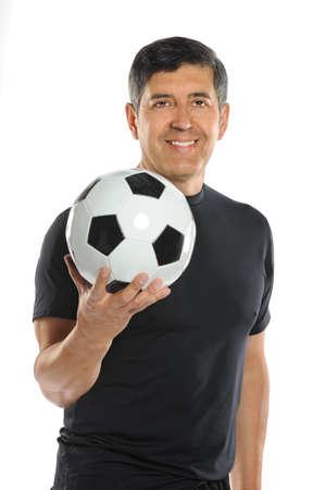 Portrait of mature Hispanic man holding soccer ball isolated over white background photo