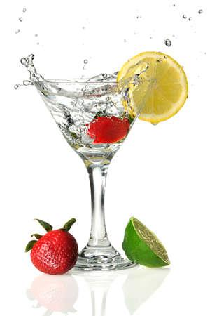 martini splash: Fruits and martini glass with liquid splashing isolated over white background Stock Photo