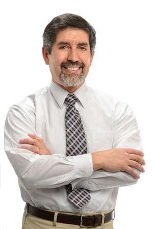 Mature Hispanic businessman smiling isolated over white background Stock Photo