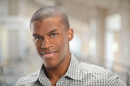 young man portrait: Portrait of young African American man smiling Stock Photo