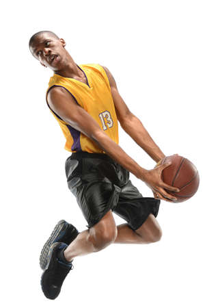 a basketball player: Basketball player jumping isolated over white background Stock Photo