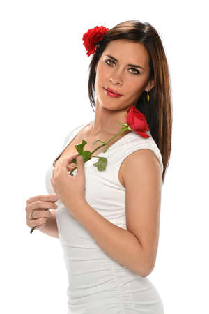 Portrait of beautiful Hispanic woman holding red rose isolated over white background photo