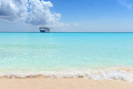 caribbean cruise: Caribbean beach with passenger cruise ship in background Stock Photo