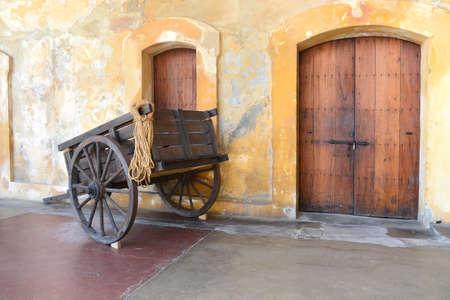 san juan: Old wooden cart in Old San Juan Puerto Rico - Castillo San Cristobal  Stock Photo