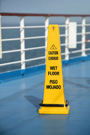 Caution Wet Floor sing on deck of cruise ship Stock Photo - 25560899
