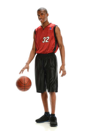 Young African American basketball player dribbling ball isolated over white background 版權商用圖片