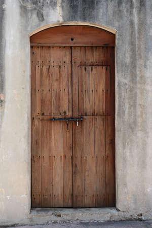 juan: Old wooden door with metal lock in Puerto Rico Stock Photo