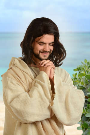 biblical: Portrait of Jesus praying by the sea