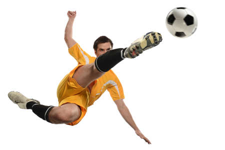 Soccer player kicking ball while jumping isolated over white background Banque d'images