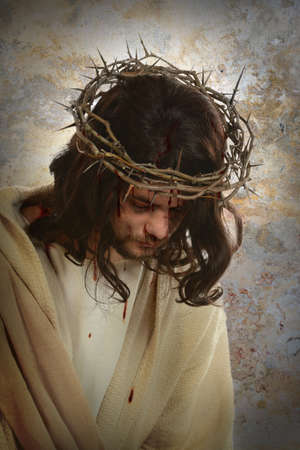 jesus christ crown of thorns: Portrait of Jesus with crown of thorns over old wall background Stock Photo