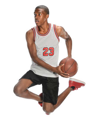 African American basketball player jumping isolated over white background