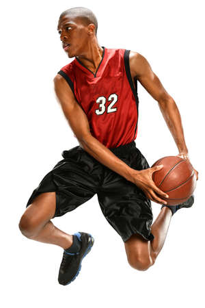 a basketball player: African American basketball player dunking ball isolated over white background Stock Photo