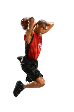 basketball player: African American basketball player jumping isolated over white background