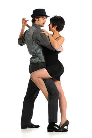 Young couple dancing tango isolated over white background Banco de Imagens