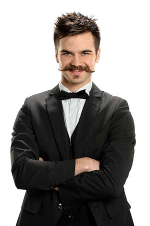 Portrait of young man wearing fancy mustache isolated over white background photo