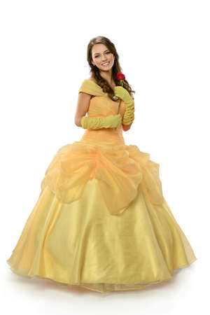 Young woman dressed in princess costume holding rose isolated over white background