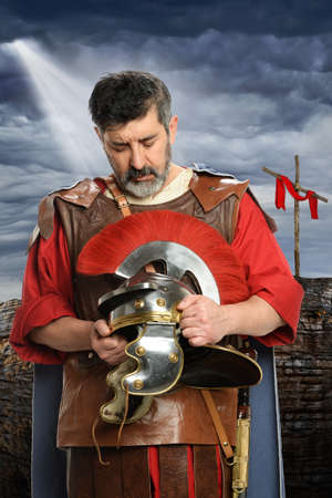 Portrait of Roman soldier praying while holding helmet