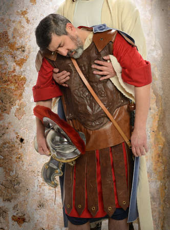 weary: Jesus hands holding exausted Roman soldier Stock Photo