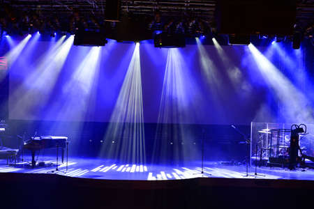 Stage with light beams and piano Editorial