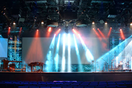 Stage lights with cross and communion trays in foreground