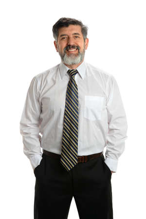 older men: Portrait of Hispanic senior businessman with hands in pockets isolated over white background Stock Photo