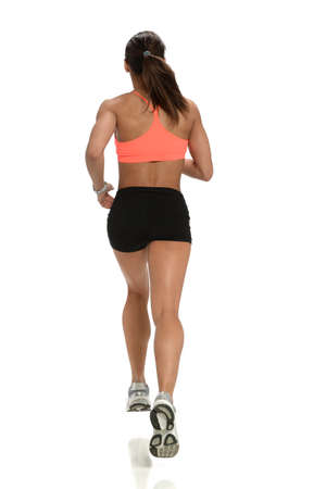Young woman running viewed from behind isolated over white background