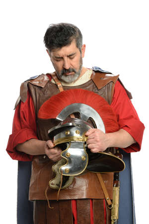 reverence: Portrait of Roman soldier praying while holding helmet