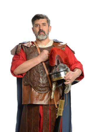 Roman soldier saluting with fist on chest isolated over white background Stock Photo