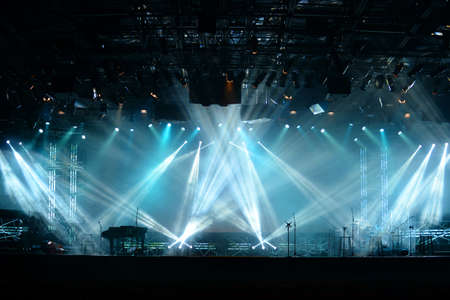 light color: Lights beams on stage with piano and musical instruments