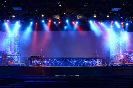light show: Stage lights before concert with musical instruments