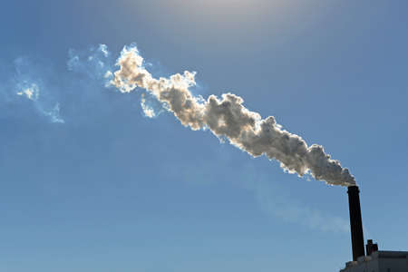 billowing: Industrial smokestack billowing smoke into atmosphere Stock Photo
