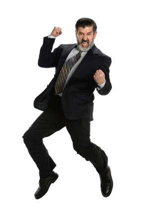businessman jumping: Hispanic businessman jumping for joy isolated over white background