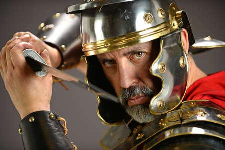 menacing: Menacing Roman soldier holding sword Stock Photo