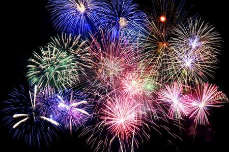 Grand finale of fireworks over dark background