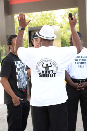 FERGUSON, MOUSA – AUGUST 15, 2014: Demonstrator being interviewd at the site of destroyed Quick Trip react after Police Chief Thomas Jackson release of the name of the officer that shot Michael Brown. Editöryel