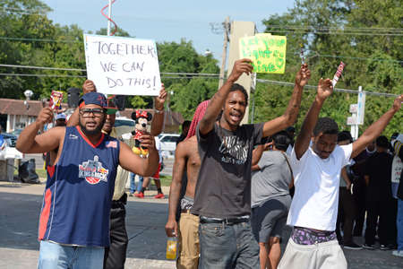 demonstrator: FERGUSON, MOUSA – AUGUST 15, 2014: Demonstrator at the site of destroyed Quick Trip react after Police Chief Thomas Jackson release of the name of the officer that shot Michael Brown.